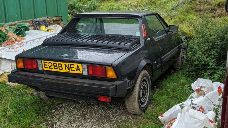 The Fiat X1/9 parked outside it's then owners barn