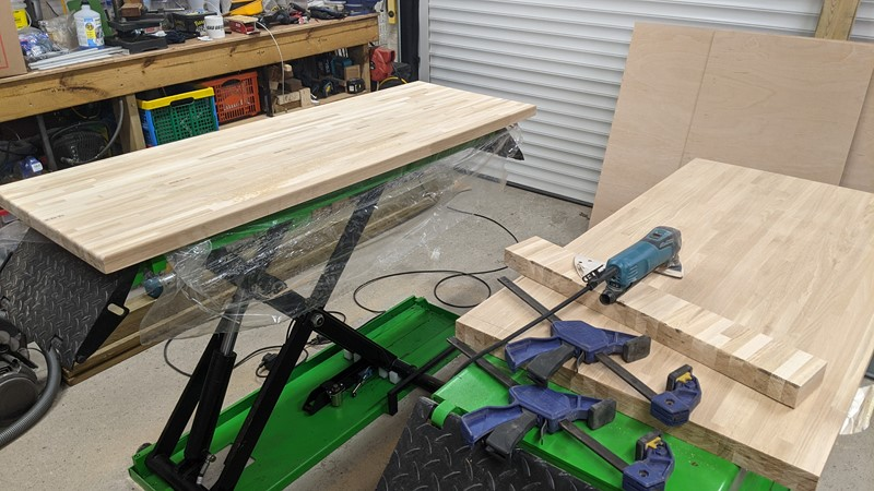 Cut trimmed and sanded oak tops for the workbenches