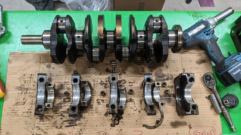 Crank shaft out of the bottom end, with both good and bad results.