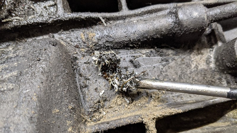 Aluminium swarf all over the engine from a stripped hole?