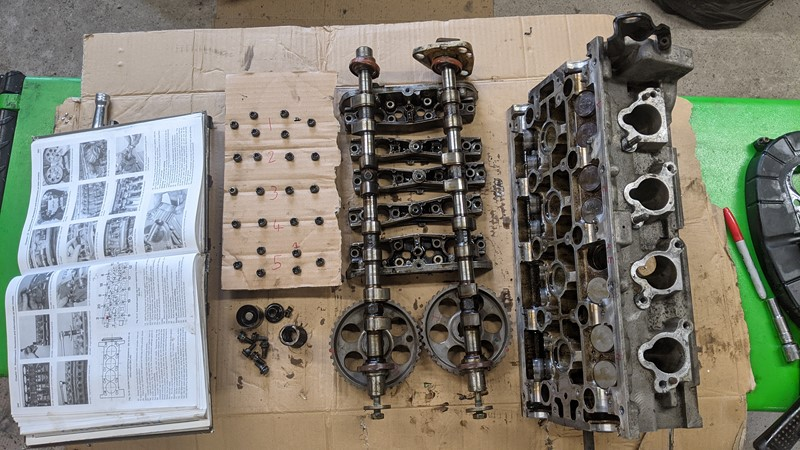 D6C cylinder head laid out on the 'bench'