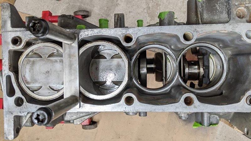 Incomplete bottom end with only two cylinders in place, after snapping rings