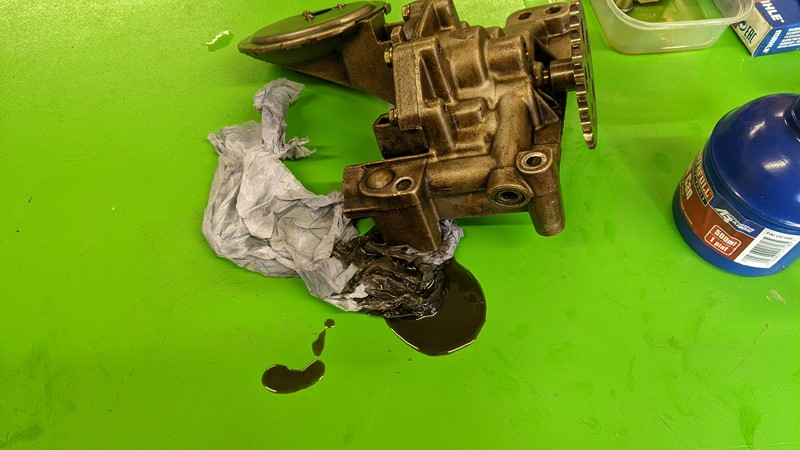 Cleaning the inside of the oil pump reveals the gunk inside