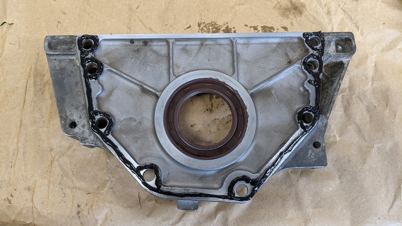 Camshaft cover plate with new seal, ready to be mated to the bottom end