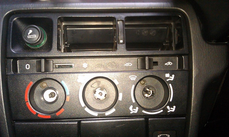 Knobs removed to access the two screws that release the heater controls