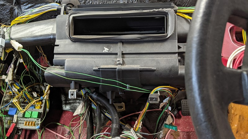 Access to the heater tap improves with the dash removed, but the wiring spaghetti makes it hard to do